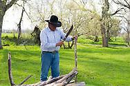 Peyote ceremony, Native American Church, Jim Real Bird, prepares firewood, Crow Indian Reservation, Montana