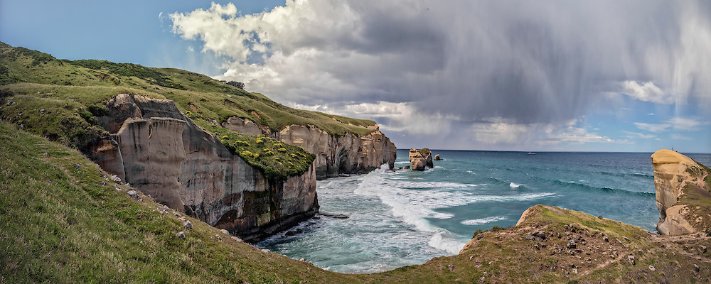 An intense storm unfurling off the coast of Tunnel Beach, New Zealand. I don't know if a photo could do justice to just how impressive and quickly these storm clouds amassed overhead, then unleashed a torrent of rain &amp; hail, then sped its own dark wet broodiness toward the distant horizon. You can even see plenty of blue sky adjacent to the sudden storm clouds. A time-lapse may have been more appropriate to capture the event, but I do like the challenge of trying to capture the moment into an image!<br />