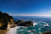 Night shot under moonlight at McWay falls at the Big Sur coastline in California.