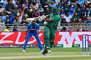 Mohammad Saifuddin of Bangladesh hits the ball to the boundary for four runs during the ICC Cricket World Cup 2019 match between Bangladesh and India at Edgbaston, Birmingham, United Kingdom on 2 July 2019.