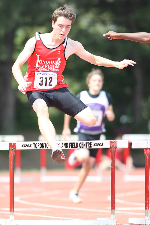 (Toronto, Ontario---2 August 2008)  Zachary Gray competing in the midget boys 200m hurdles at the 2008 OTFA Supermeet II, the Bantam, Midget, Youth Track and Field Championships. This image is copyright Sean W. Burges, and the photographer can be contacted at www.msievents.com.