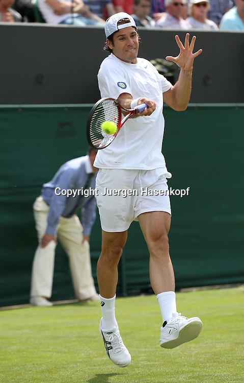 Wimbledon Championships 2013, AELTC,London,<br /> ITF Grand Slam Tennis Tournament, Tommy Haas(GER),Aktion,Einzelbild,Ganzkoerper,Hochformat,