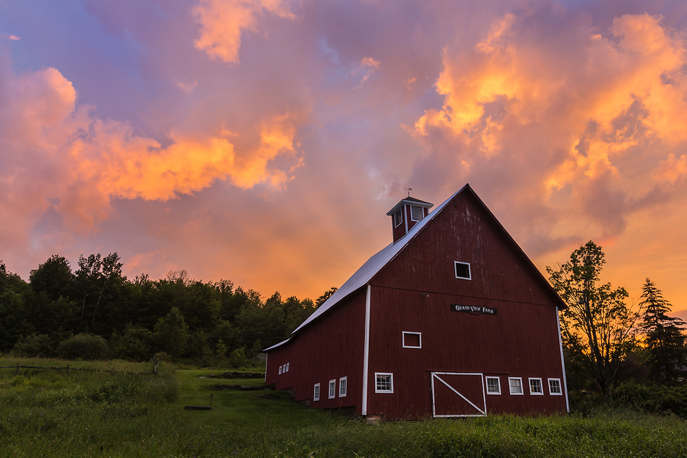 Grandview Farm with blazing sunset sky near Stowe, VT