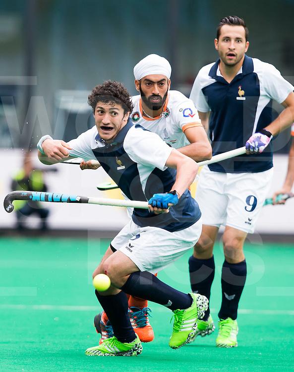 BRASSCHAAT (ANTWERP - Belgium) -  Siman MARTIN BRISAC with Gurmail SINGH  during the Fintro Hockey World League Semi-Final match between the men of India and France (3-2) COPYRIGHT WORLDSPORTPICS KOEN SUYK