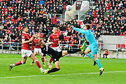 Frank Fielding (1) of Bristol City punches the ball away from Liam Cooper (6) of Leeds United during the EFL Sky Bet Championship match between Bristol City and Leeds United at Ashton Gate, Bristol, England on 21 October 2017. Photo by Graham Hunt.