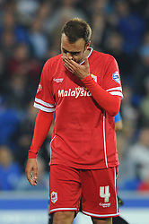 Cardiff City's Juan Cala cuts a dejected figure as his side lose 0 - 3 to AFC Bournemouth in the Capital One league cup - Photo mandatory by-line: Dougie Allward/JMP - Mobile: 07966 386802 - 23/09/2014 - SPORT - FOOTBALL - Cardiff - Cardiff City Arena - Cardiff City v AFC Bournemouth - Capital One Cup - Third Round