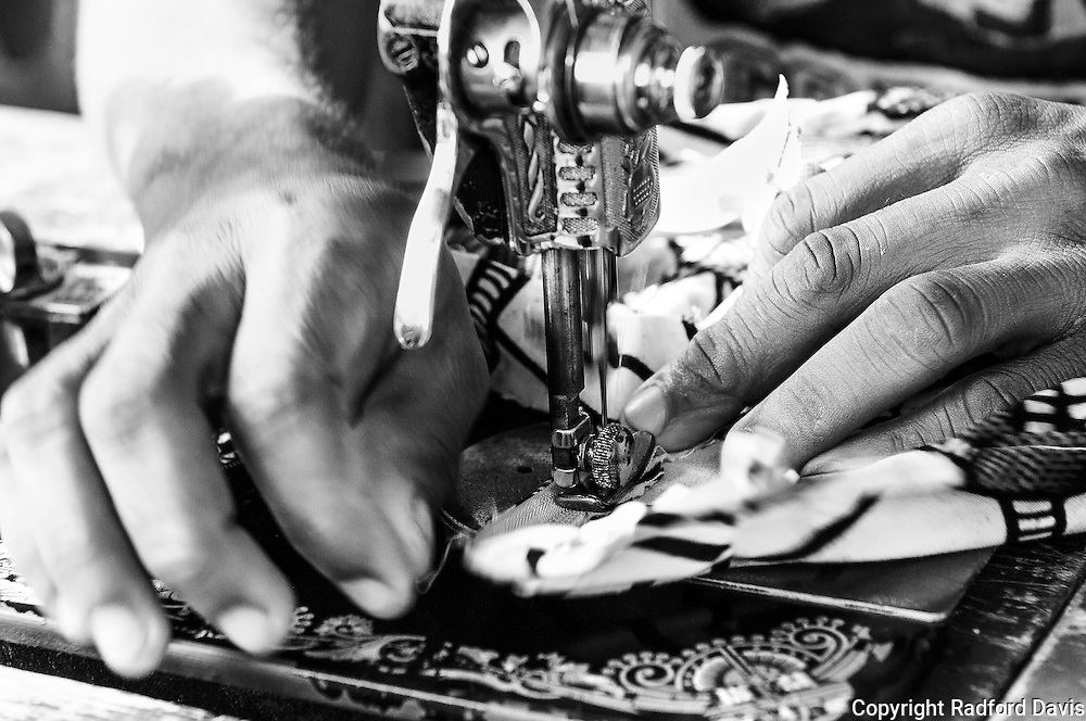 The hands of a tailor in Kabala, Sierra Leone