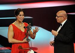 12-12-2011 ALGEMEEN: NOS NOC NSF SPORTGALA: DEN HAAG<br /> Zwemster Ranomi Kromowidjojo is verkozen tot sportvrouw van het jaar en ontvangt uit handen van Kees Jansma de Jaap Eden tijdens het NOC NSF Sportgala 2011 in Den Haag<br /> ©2011-WWW.FOTOHOOGENDOORN.NL