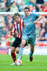 SUNDERLAND, ENGLAND - Saturday, August 16, 2008: Liverpool's Jamie Carragher in action against Sunderland during the opening Premiership match of the season at the Stadium of Light. (Photo by David Rawcliffe/Propaganda)