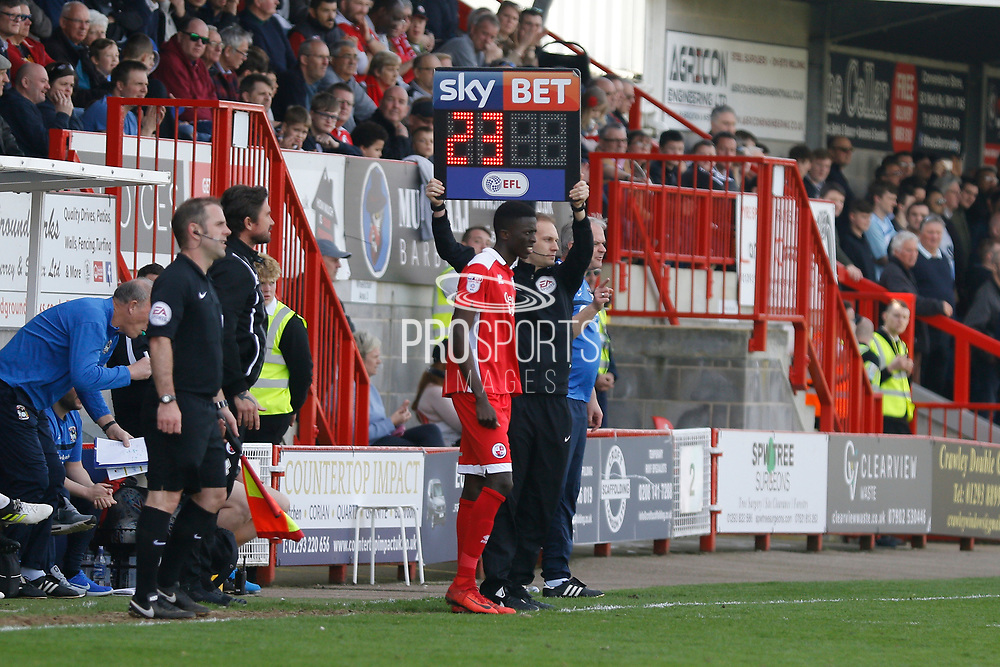Fourth official Louis Marks holds up the Sky Bet board to schedule a substitution during the EFL Sky Bet League 2 match between Crawley Town and Coventry City at the Checkatrade.com Stadium, Crawley, England on 14 April 2018. Picture by Andy Walter.