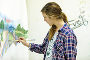 Ohio University student Anna Moore works on a painting in Seigfred Hall on Sunday, December 2, 2012.  (© Ohio University/ Brien Vincent)