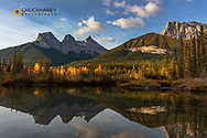 Three Sisters reflect into pool in Canmore, Alberta, Canada