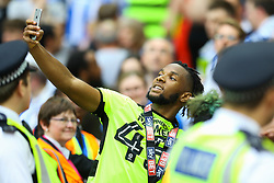 Free to use courtesy of Sky Bet, Huddersfield Town win the Championship Play off and head to the Premier League, Kasey Palmer of Huddersfield Town grabs a fans mobile - Mandatory by-line: Jason Brown/JMP - 29/05/2017 - FOOTBALL - Wembley Stadium - London, England - Huddersfield Town v Reading - Sky Bet Championship Play-off Final