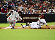 Sep. 14, 2012; Phoenix, AZ, USA; San Francisco Giants infielder Pablo Sandoval (48) tags out Arizona Diamondbacks outfielder Adam Eaton (6) as he attempts to steal third base in the first inning at Chase Field.  Mandatory Credit: Jennifer Stewart-US PRESSWIRE