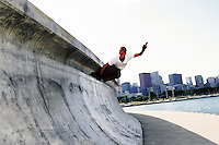 1996: Inline skater Brian Smith catches air off a cement wall near Lake Michigan in Chicago, IL.  Skating the streets for BAUER after NSGA in town. Transparency slide scan.