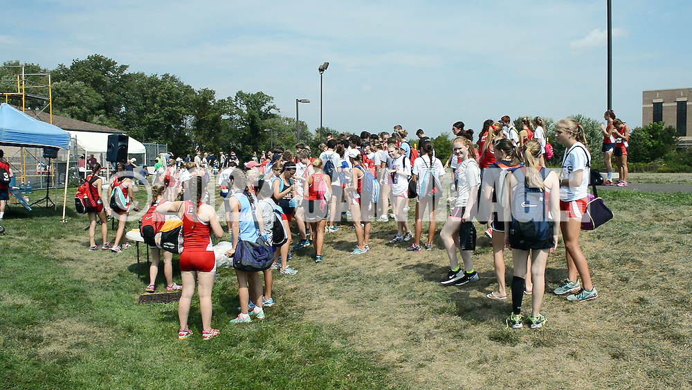 WARRINGTON, PA - SEPTEMBER 06: Central Bucks East students wait for their bus after  a track meet at Central Bucks South high school September 6, 2014 in Warrington, Pennsylvania. According to witnesses, 8 athletes passed out and were taken to the hospital from the hot weather during a track meet at South.  (Photo by William Thomas Cain/Cain Images)
