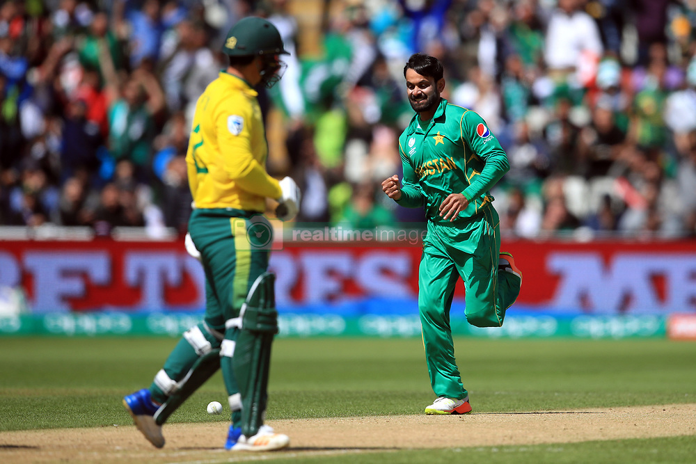 Pakistan's Mohammad Hafeez (right) celebrates the wicket of South Africa's Quinton de Kock (left) for 33 during the ICC Champions Trophy, Group B match at Edgbaston, Birmingham.