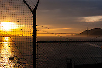 United States, California, San Francisco. Sunset view towards the Golden Gate bridge from Alcatraz.