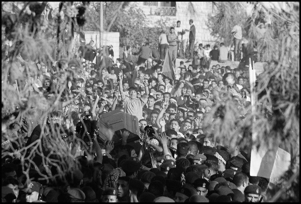 Yasser Arafat's coffin is carried through the sea of Palestininas who came to Al-Muqataa to celebrate the life of the Palestinian leader.