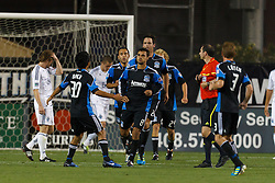 July 20, 2011; Santa Clara, CA, USA;  San Jose Earthquakes forward Chris Wondolowski (center) is congratulated by teammates after scoring a goal against the Vancouver Whitecaps during the second half at Buck Shaw Stadium. San Jose tied Vancouver 2-2.