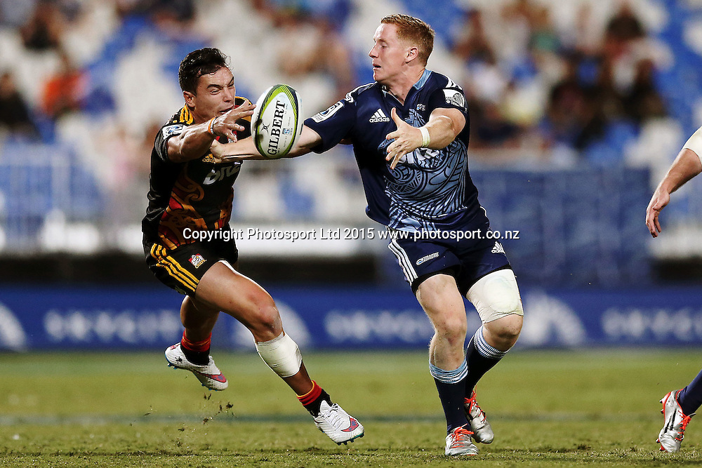 Hamish Northcot of the Blues offloads against James Lowe of the Chiefs. Super Rugby match, Blues v Chiefs at QBE Stadium, Auckland, New Zealand. Saturday 14 February 2015. Photo: Anthony Au-Yeung / www.photosport.co.nz