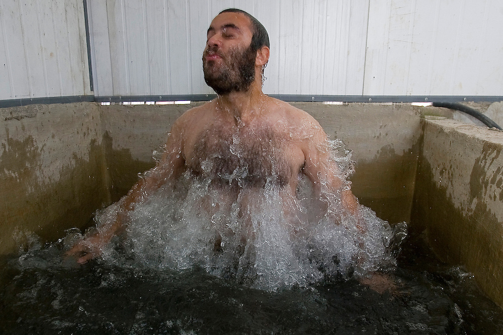 An Israel settler bath in the mikveh, ritual bath, to purifier himself in the settlement of Havat Gilad.