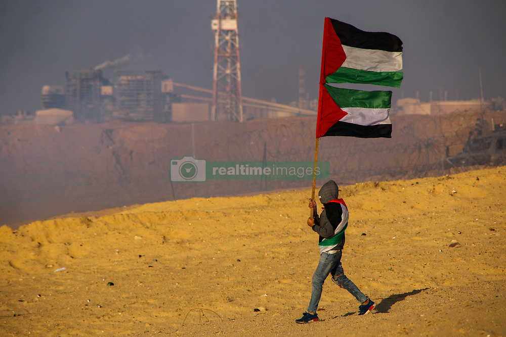 November 19, 2018 - Palestinian protesters injured in northern Gaza clashes..A number of Palestinians protesters are injured in clashes with Israeli troops on the west of Bait Lahiya in northern Gaza on 19th November 2018. Some of the Palestinians demonstrators moved close to the fence and hurled stones towards the Israeli soldiers situated of the other site of the barrier in the Israeli site of Zakim, while the Israeli army fired live and rubber ammunitions and tear gas at the protesters causing a number of injuries. Journalist Ahmad Hasaballah was among the casualties when his left hand was injured after being hit by an Israeli rubber grenade while covering the protest. Palestinians in Gaza have been protesting since March 30th demanding an end to the Israeli blockade on Gaza, the right of Palestinian refugees to return to their ancestral land, and against  US President Trump's decision to recognize Jerusalem as the capital of Israel. According to the Gaza Health Ministry during the clashes following the demonstrations more than 230 Gazans have been killed and over 23,000 others wounded (Credit Image: © Ahmad Hasaballah/IMAGESLIVE via ZUMA Wire)