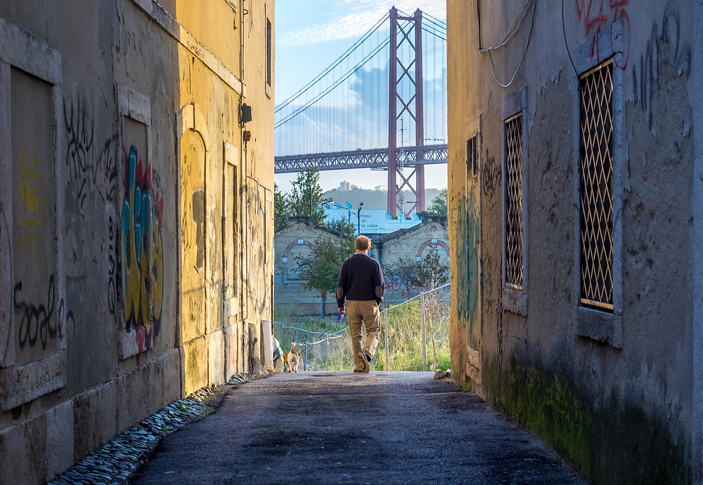 Late afternoon pedestrian with Lisbon's echo of the SF Golden Gate bridge in view