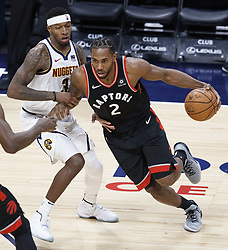 December 16, 2018 - Denver, Colorado, U.S - Raptors KAWHI LEONARD, center, makes a run to the basket during the 1st. Half at the Pepsi Center Sunday evening. The Nuggets beat the Raptors 95-86. (Credit Image: © Hector Acevedo/ZUMA Wire)