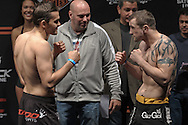 "COLOGNE, GERMANY, JUNE 12, 2009: Peter Sobotta (left) and Paul Taylor face off at the official weigh-in for ""UFC 99: The Comeback"" inside LanXess Arena in Cologne, Germany on June 12, 2009"