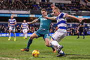 Queens Park Rangers defender Jake Bidwell (3), Wigan Athletic defender Jake Buxton (3) during the EFL Sky Bet Championship match between Queens Park Rangers and Wigan Athletic at the Loftus Road Stadium, London, England on 21 February 2017. Photo by Sebastian Frej.