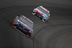 June 10, 2018 - Brooklyn, Michigan, United States of America - Denny Hamlin (11) races off turn one during the FireKeepers Casino 400 at Michigan International Speedway in Brooklyn, Michigan. (Credit Image: © Stephen A. Arce/ASP via ZUMA Wire)