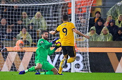 WOLVERHAMPTON, ENGLAND - Friday, December 21, 2018: Liverpool's goalkeeper Alisson Becker makes a save from Wolverhampton Wanderers' Raúl Jiménez during the FA Premier League match between Wolverhampton Wanderers FC and Liverpool FC at Molineux Stadium. (Pic by David Rawcliffe/Propaganda)