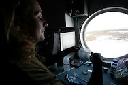 Kathryn Bywaters  (27) working in the lab on The FMARS (Flashline Mars Arctic Research Station)...Mars flashline Mars arctic (FMARS)..On Devon Island in the high Canadian Arctic a group of sciences from the USA & Canada is gathering for four month to search watt human being can do on mars planet..The four month mission will be the first time that a simulated Mars mission has ever been conducted for such a long duration..The crow of volunteers includes some biologist geologist and other nether scientist researches...They chose Devon Island in Canada because it simulated the acclaim on the planet Mars, for getting the filling of being on Mars and to challenge the research and to make it close as they can to the conditions on the planet they wear spies suit and live isolated in the laboratory for four month..The man person that ran the project is Dr Robert Zabrin that believe that this project can lied to find ways to search for life on Mars and maybe to fined a way that human being will be able to live on the planet...This project is privet projects that cooperate with several universities around the world...