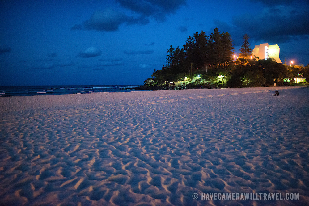 "Looking towards Pat Fagan Park over teh sand on the headland at Coolangatta at dusk. Sometimes paired as ""Twin Towns,"" Coolangatta and Tweed Heads, on the southern end of the Gold Coast, straddle the Queensland-New South Wales border."
