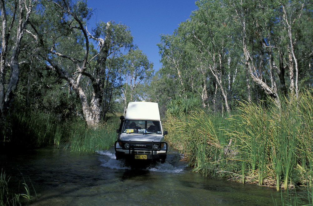 Land Cruiser crossing Gregory River.at Riversleigh.Queensland.Australia