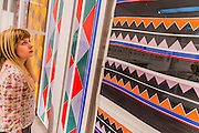 A reconstructed shop window of her Simultaneous Boutique and fabrics -  Retrospective of Sonia Delaunay (1885–1979), a key figure in the Parisian avant-garde, renowned for her vivid and colourful paintings and textiles. The exhibition covers the breadth of her vibrant artistic career, from 1907 to 1970, showcasing her originality and creativity across the twentieth century. Highlights include: Three 7-metre murals, Motor, Dashboard and Propeller, created for the 1937 International Exposition in Paris and never before shown in the UK; A reconstructed shop window of Delaunay's 1920s Paris atelier, showcasing a motorised display of her multi-coloured textiles; Electric Prisms 1914, a large colourful painting capturing the energy of modern urban life, on loan from the Centre Pompidou in Paris; Costumes, dresses and scarves designed by Delaunay for clients including the Hollywood star Gloria Swanson, Diaghilev's Ballets Russes, and departments stories like Metz & Co and Liberty. The EY Exhibition: Sonia Delaunay is at Tate Modern from 15 April to 9 August 2015.