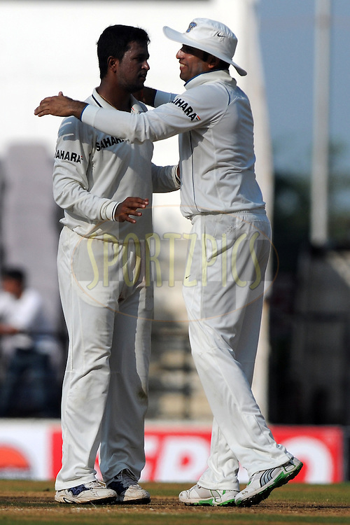 Pragyan Ojha of India celebrates a wicket during day 1 of the third test between India and New Zealand held at the Vidarbha Cricket Stadium in Nagpur on the 20th November 2010..Photo by Pal Pillai/BCCI/SPORTZPICS