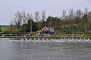 Henley. United Kingdom. Oxford Women's Blue Boat passing Remenham Club as they go on to win the 2014 Henley Boat Race, Henley Reach, Annual Women's Boat Race.  River Thames; <br />  Sunday  - 30/03/2014  [Mandatory Credit; Intersport Images],