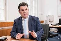 07 MAR 2019, BERLIN/GERMANY:<br /> Hubertus Heil, SPD, Bundesarbeitsminister, waehrend einem Interview, in seinem Buero, Bundesministerium fuer Arbeit und Soziales<br /> IMAGE: 20190307-01-016<br /> KEYWORDS: Büro