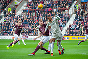 Jimmy Dunne (#3) of Heart of Midlothian holds off Max Lowe (#29) of Aberdeen FC during the Ladbrokes Scottish Premiership match between Heart of Midlothian and Aberdeen at Tynecastle Stadium, Edinburgh, Scotland on 20 October 2018.