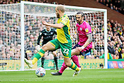 Norwich City forward Teemu Pukki (22) trying to turn onto goal during the EFL Sky Bet Championship match between Norwich City and Queens Park Rangers at Carrow Road, Norwich, England on 6 April 2019.