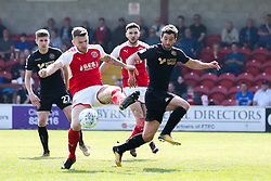 Ashley Eastham of Fleetwood Town clears the ball from Will Grigg of Wigan Athletic - Mandatory by-line: Robbie Stephenson/JMP - 21/04/2018 - FOOTBALL - Highbury Stadium - Fleetwood, England - Fleetwood Town v Wigan Athletic - Sky Bet League One