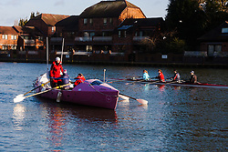 Marlow, Bucks, January 24th 2015. Olympic and Paralympic rowing medallists including Naomi Riches, Heather Stanning and Katherine Grainger join members of a Coxless Crew at Marlow at their boat naming ceremony. The Coxless Crew is a team of four women who have given up their jobs to undertake an epic six-month 8,446 mile adventure rowing their boat Doris across the Pacific ocean from Sanfrancisco to Cairns in Australia, to raise funds for charities Walking With The Wounded and Breast Cancer Care. PICTURED: A coxless four passes the Coxless Crew's trans-pacific rowing boat Doris on the River Thames.
