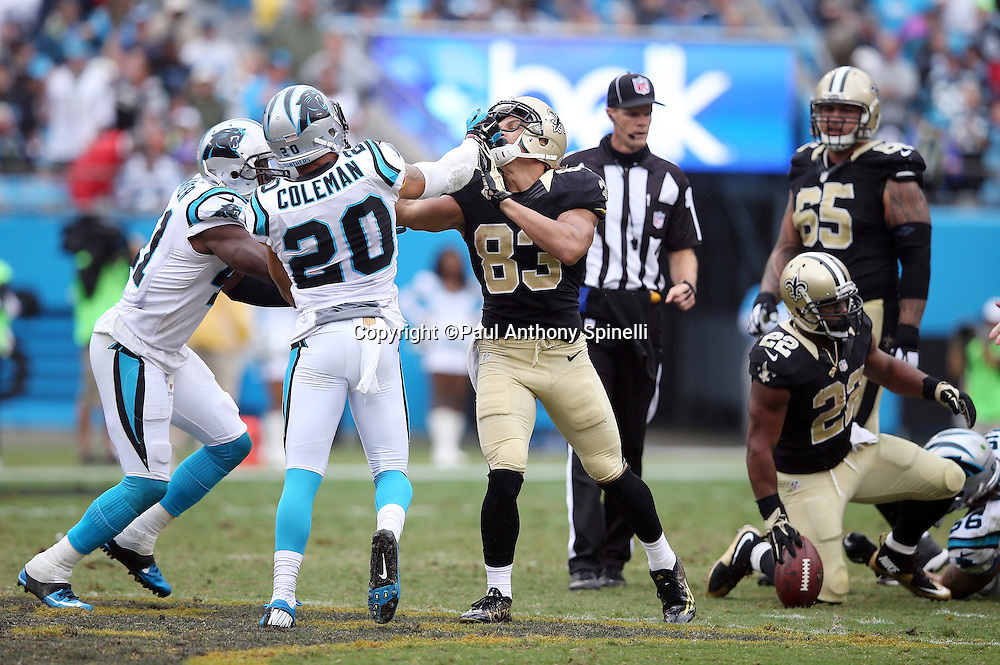 New Orleans Saints wide receiver Willie Snead (83) gets into a scuffle with Carolina Panthers free safety Kurt Coleman (20) during the 2015 NFL week 3 regular season football game against the Carolina Panthers on Sunday, Sept. 27, 2015 in Charlotte, N.C. The Panthers won the game 27-22. (©Paul Anthony Spinelli)