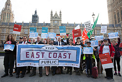 © Licensed to London News Pictures. 18/10/2013. London, UK. Protesters, including General Secretary of the National Union of Rail, Maritime and Transport Workers, Bob Crow (centre bald head), Labour Rail Minister, Lilian Greenwood (left of Mr Crow), and recently arrested Green Part MP Caroline Lucas (right of Mr Crow) are at a protest against the re-privatisation of the United Kingdom's East Coast Line in London today (18/10/2013) ahead of handing in a petition consisting of 23,000 commuter's signatures to the transport ministry. The East Coast Line, which runs from London to Scotland, is currently the only publicly owned train line after passing to the government from previous operator National Express who encountered financial difficulties. Photo credit: Matt Cetti-Roberts/LNP