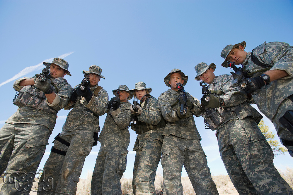 Group portrait of soldiers aiming guns
