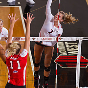 26 August 2016: The San Diego State Aztecs took on the Marist Red Foxes to open up the season.  OH Hannah Turnlund (7) spikes the ball in the first set. The Aztecs swept the Red Foxes 3-0 in their opening match of the Aztec Invitational at Peterson Gym on the campus of SDSU. www.sdsuaztecphotos.com