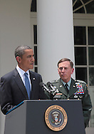 President Barack Obama announces the appointment of General David Petraeus to be commander of Western Forces in Afghanistan. Photograph by Dennis Brack