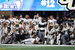 The UCF Knights celebrate a touchdown on the sidelines during the 2018 Chick-fil-A Peach Bowl NCAA football game against the Auburn Tigers on Monday, January 1, 2018 in Atlanta. (Jason Parkhurst / Abell Images for the Chick-fil-A Peach Bowl)